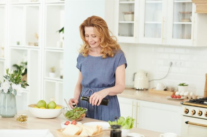 elegant-mature-woman-cooking-VN3UA6N